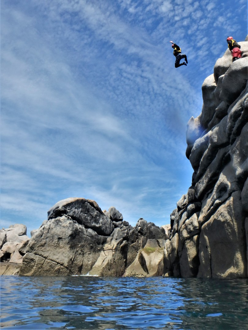 Amazing cliff jump coasteering at Peninnis Head on Isles of Scilly