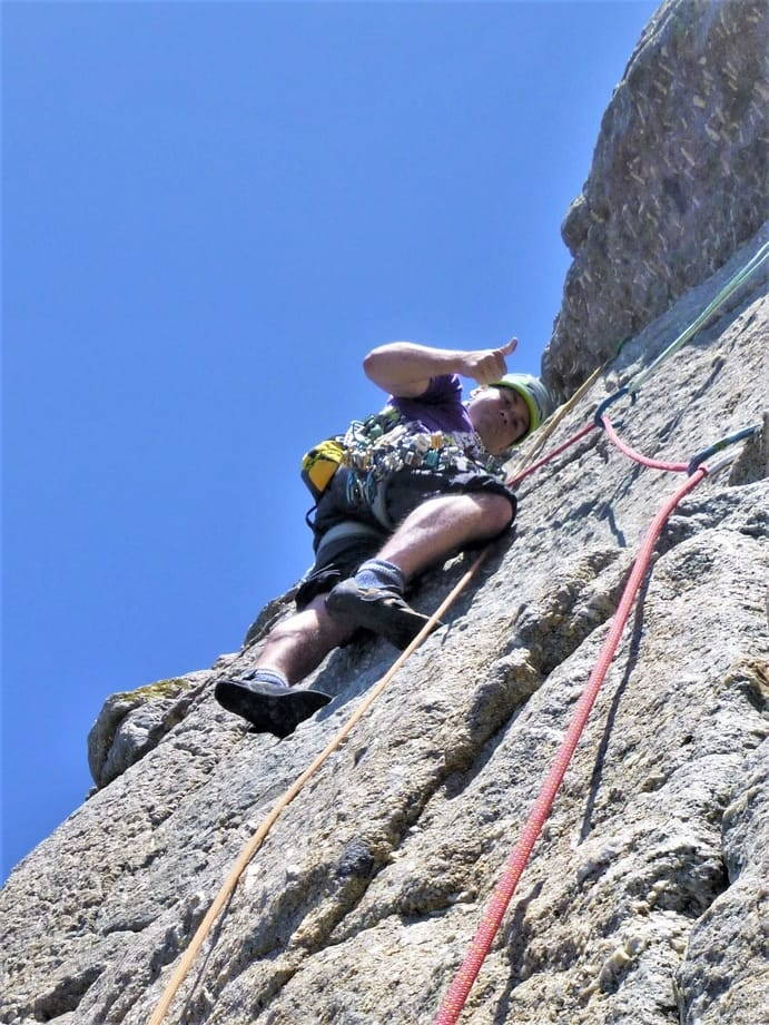 Cornwall rock climbing guide leading a route at Chair Ladder, a granite cliff near Land's End and Penzance.