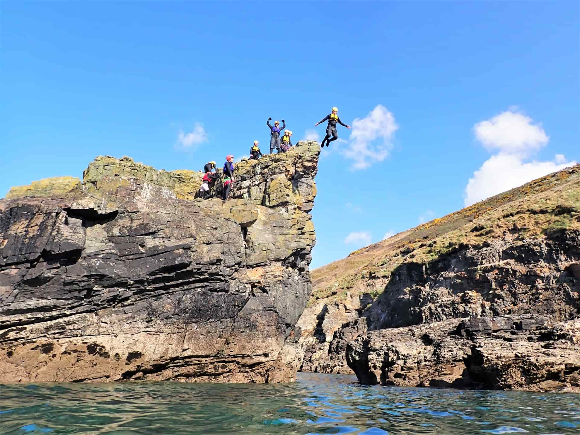 Cliff jumper at Praa sands doing one of the best jumps coasteering with Kernow Coasteering Cornwall