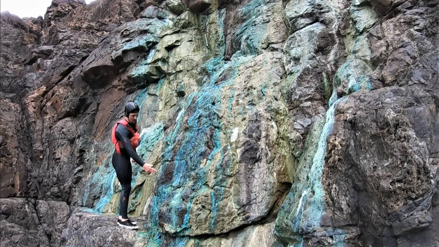 Coasteering from St. Ives to Penzance in Cornwall, we have discovered these brightly coloured copper mineral flows.