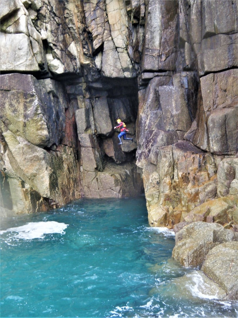 Cliff jumping at Land's End Cornwall on a Cornwall coasteering adventure near Sennen Cove