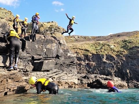 Medium sized cliff jump on a beginner coasteering session at Praa Sands, Cornwall