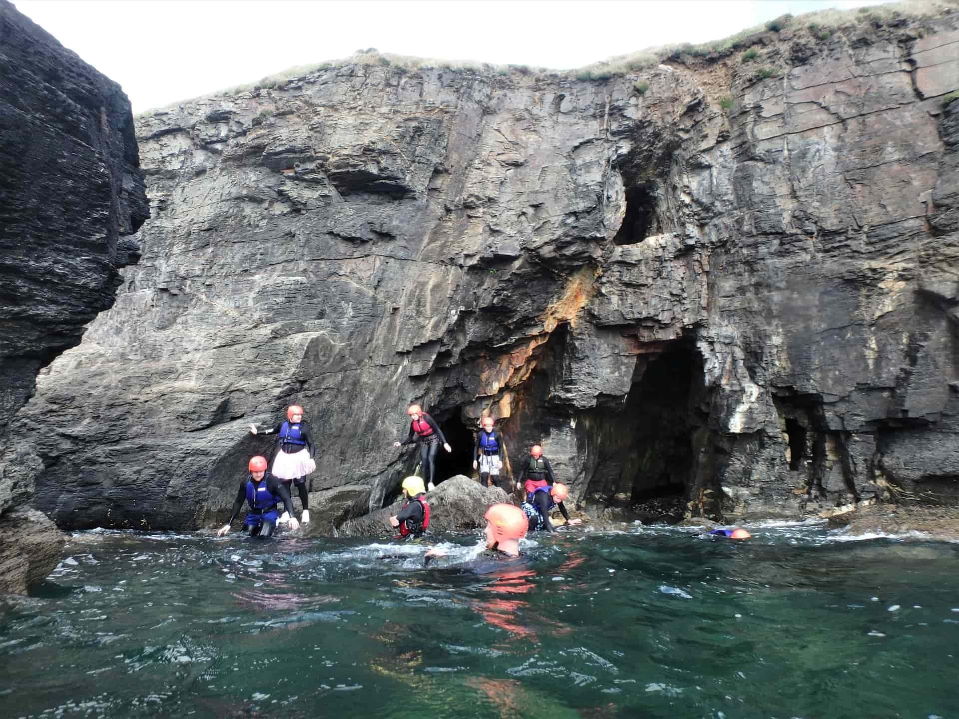 Coasteering at Praa Sands under an old Cornish mine. Coasteering with Cornish history with Kernow Coasteering