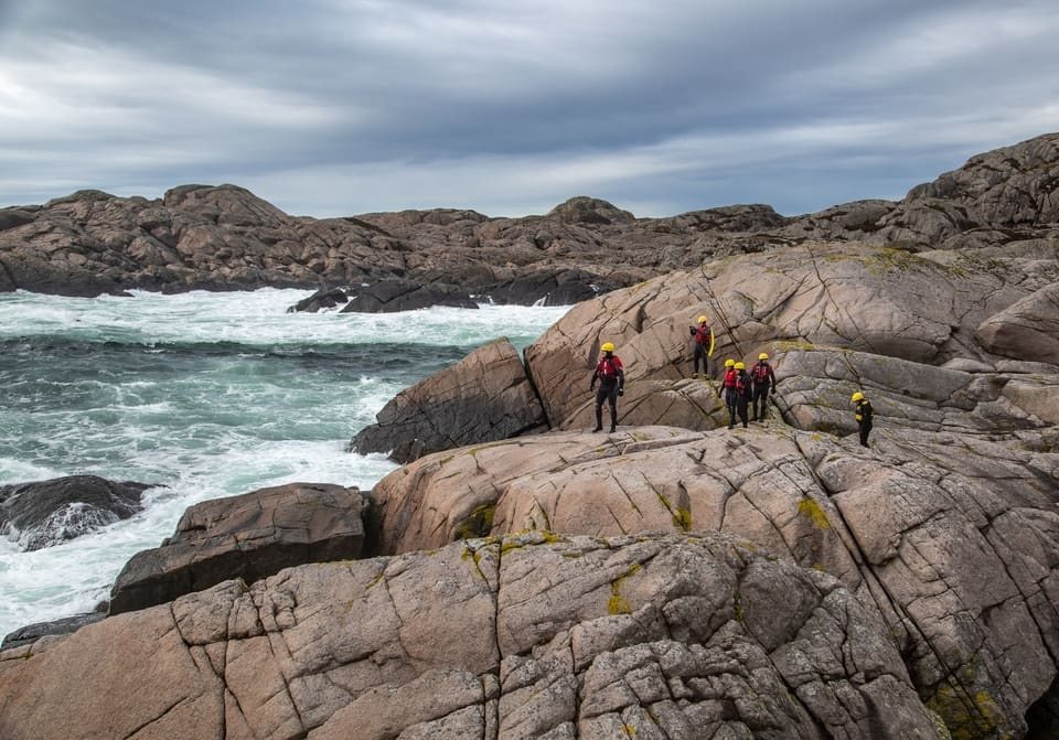 Traversing an amazing barren landscape coasteering in Norway