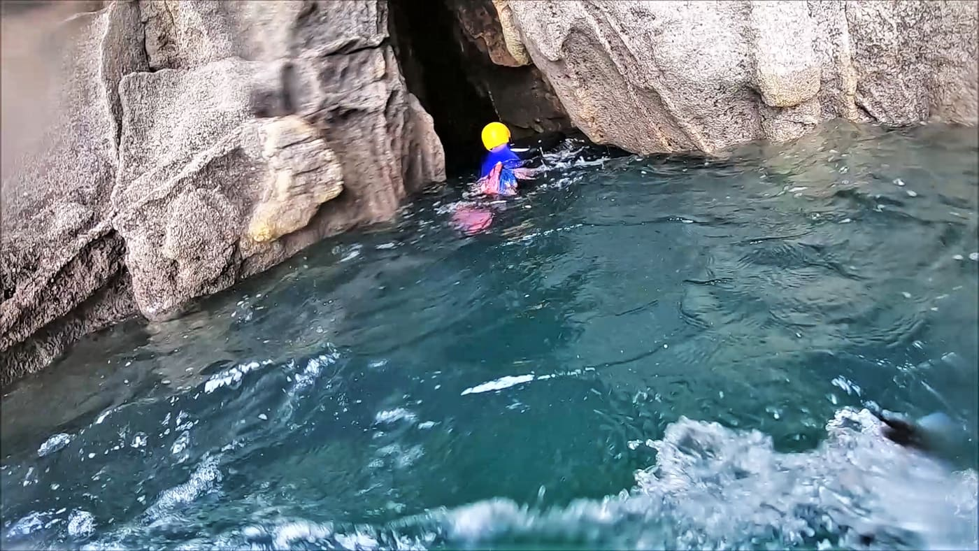 Coasteering into a Sea Cave at Rinsey Head near Porthleven, Cornwall