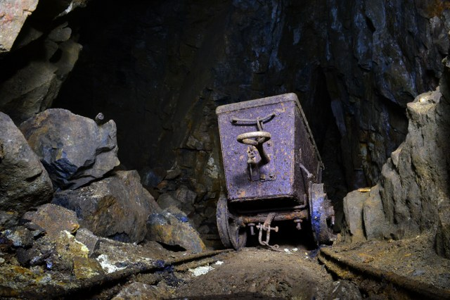 MIne exploration and caving trips now available in Cornwall. Here mine explorers discover an abandoned ore cart in a tine mine