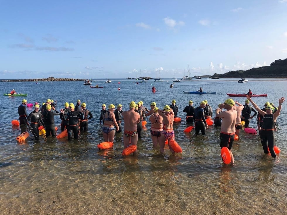 Crowd taking part in the Scilly Swim Challenge.