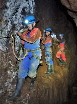 Group journeying through a Cornish tin mine by abseiling and via ferrata with Cornwall Underground Adventures.