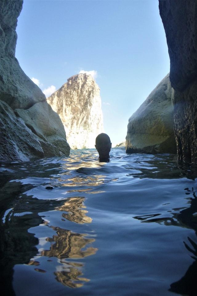Kernow Coasteering exploring a cave in Santorini, Greece