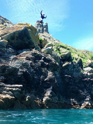 Huge cliff jump at Prussia Cove with Kernow Coasteering. Best coasteering in Cornwall with Kernow Coasteering.