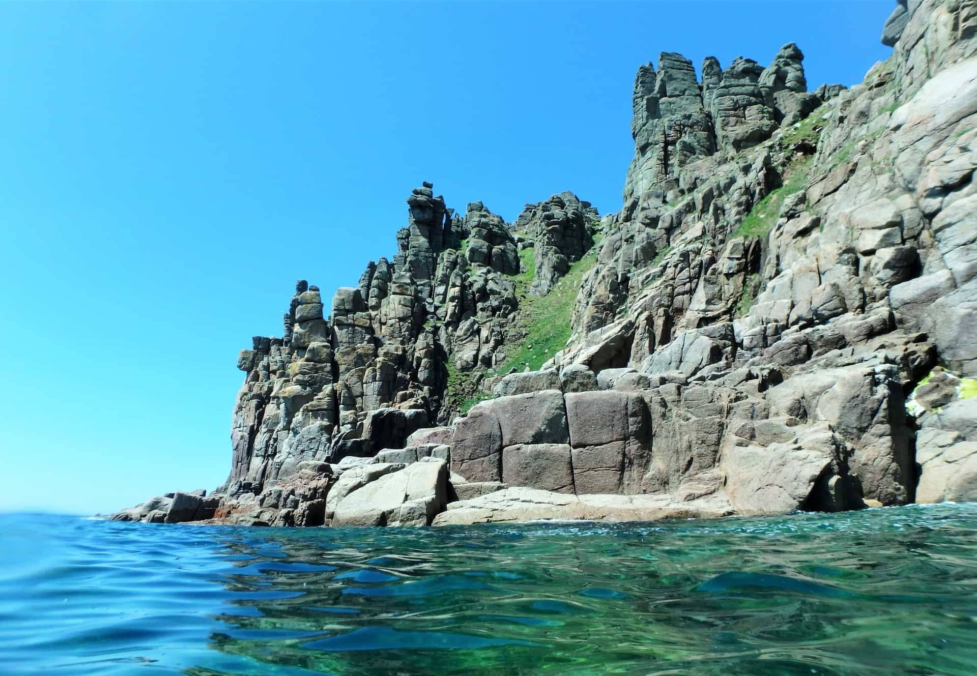 Huge granite cliffs at Pordenack Point, Cornwall. As seen from sea level, whilst coasteering