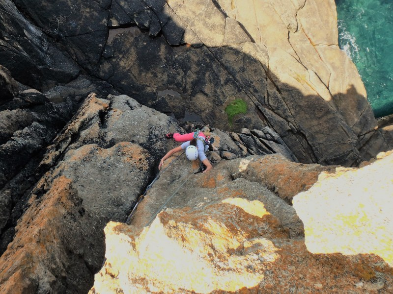 Climber on Civvy Route, HS, at Sennen during an intermediate rock climbing course with Kernow Coasteering