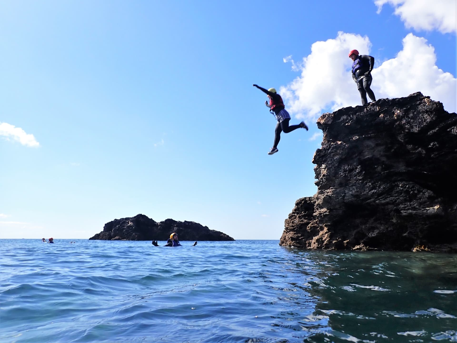Jumping between the many small islands that make up coasteering at Praa Sands with Kernow Coasteering in Cornwall