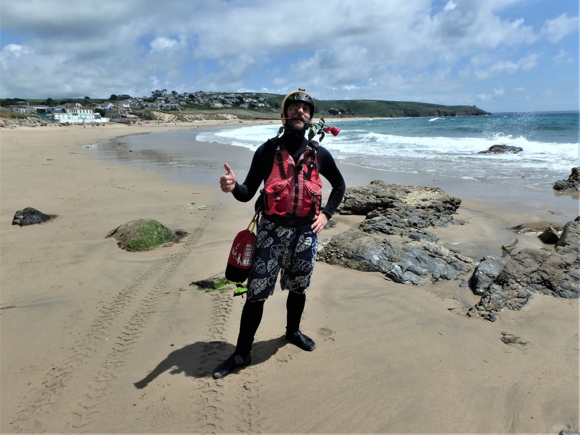 Coasteering guide on beach at Praa sands, Cornwall, ready for a session with Kernow Coasteering