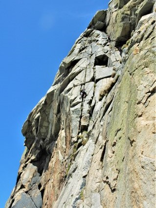 Cimbing Doorpost at Bosigran. A classic multi pitch rock climb at Bosgran near Penzance and St Ives in Cornwall. Rock climbing i