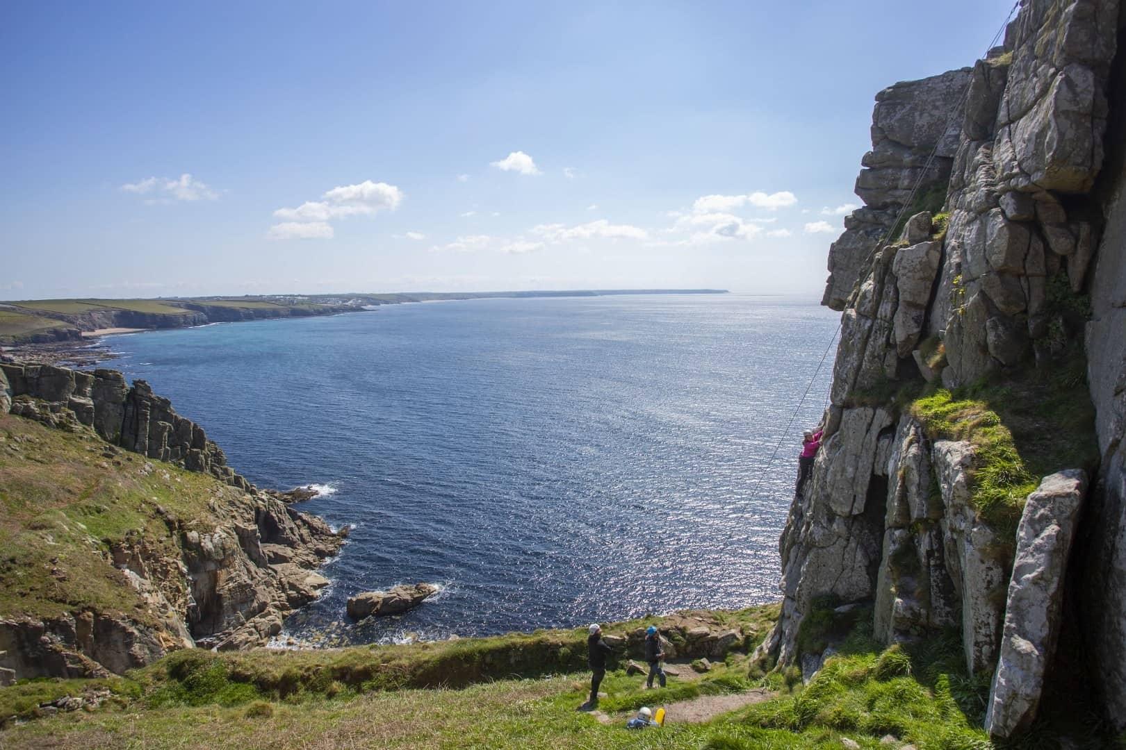 Beginner rock climbing at Trewavas Head, near Praa Sands Cornwall