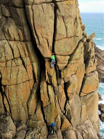 Rock climbing Sea Horse, HVS at Chair Ladder near Porthcurno and Land's End. Cornwall's best climbing on the granite sea cliffs