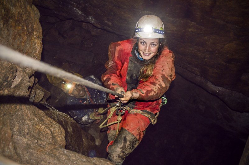 MIne explorer abseiling deep in a Cornish tin mine