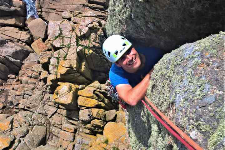 Rock climber at Chair Ladder on a Kernow Coasteering rock climbing course. Learn to climb in Cornwall with kernow Coasteering.