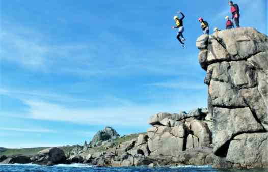 Big cliff jump coasteering in Cornwall and the Isles of Scilly. Here's one at Peninnis Head, St. Mary's