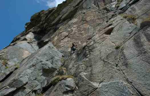 Rock climbers on Doorpost at Bosigran. A classic Cornish rock climbing route.