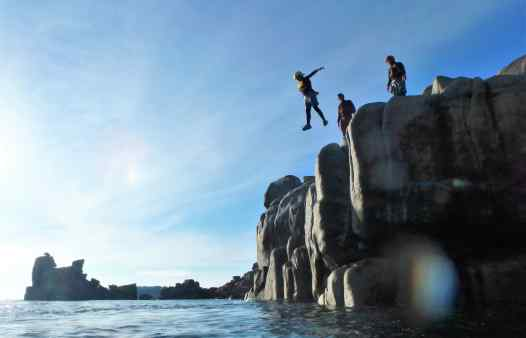 Jumping into the sunset, coasteering on the Isles of Scilly