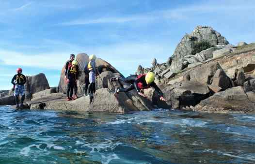 Coasteere making an enthusiastic start to a coasteering session on the Isles of Scilly