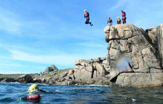Cliff jump at Peninnis Inner Head, Coasteering on the Isles of Scilly