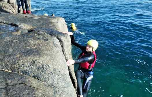 Climbing the golden granite of Scilly on a coasteering session