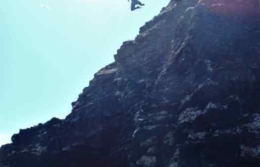 Huge jump form a cliff whist coasteering in Cornwall with Kernow Coasteering