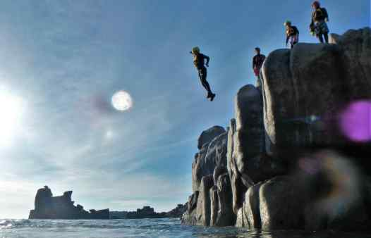 One of the best cliff jumps at Peninnis Head, coasteering on the Isles of Scilly