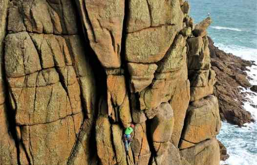 Climber on Sea Horse, HVS, at Chair Ladder, a rock climbing crag in Cornwall