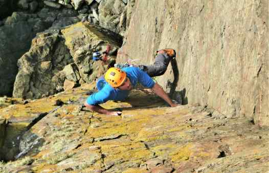 Rock climber on Thane, E1 at Kenidjack, a rock climbing route in Cornwall