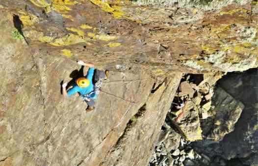 Kernow Coasteering climbing instructor on Thane, E1, at Kenidjack, Cornwall