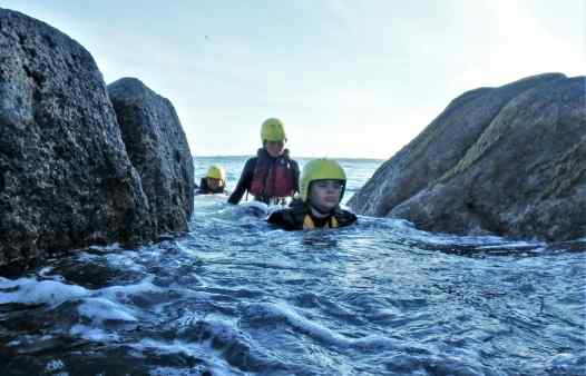 Swimming the clashing rock whilst coasteering on Scilly
