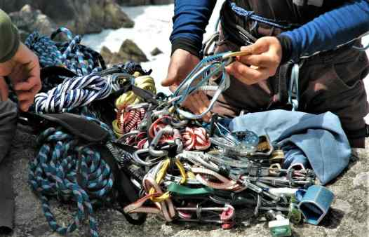 Sorting out rock climbing gear before climbing at Bosigran near St. Ives in Cornwall